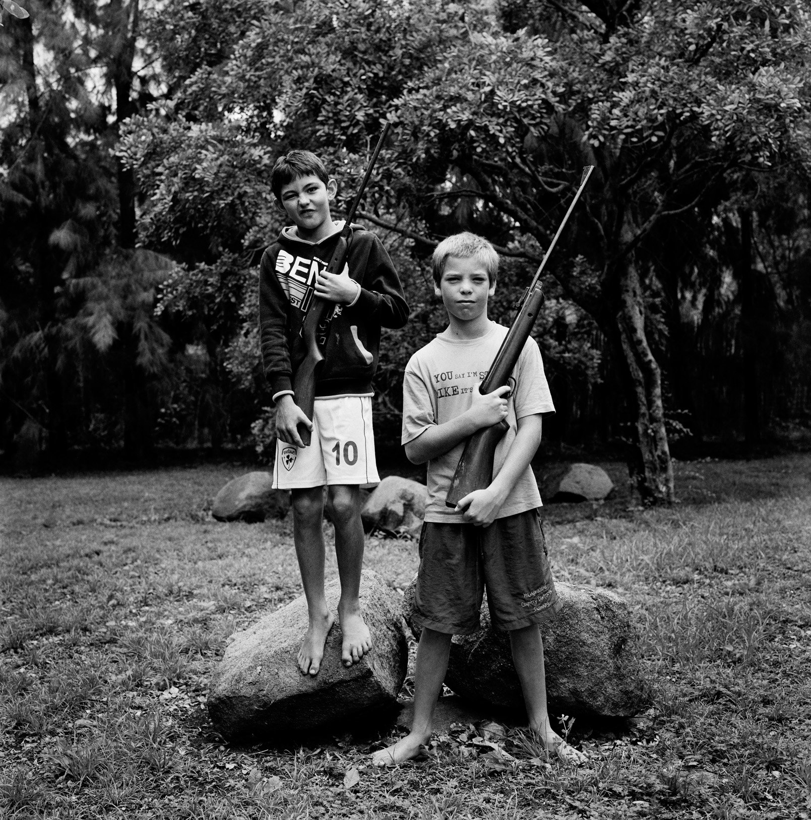 5. Katharine Cooper, Boys with pellet guns on Ledbury Farm, Mazowe, Zimbabwe, 2013, Photo Katharine Cooper_LR.jpg